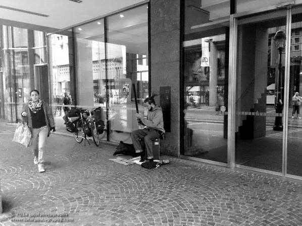 A street musician set his insurtment before perofrming, location: Freiburg - Germany